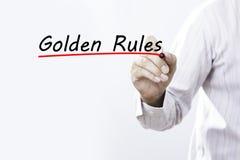Zakenmanhand het schrijven Gulden regels met rode teller op transpa royalty-vrije stock foto's