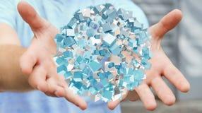 Zakenmanholding die abstract gebied met glanzende kubus 3D vliegen aangaande Royalty-vrije Stock Afbeeldingen