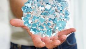 Zakenmanholding die abstract gebied met glanzende kubus 3D vliegen aangaande Royalty-vrije Stock Foto's