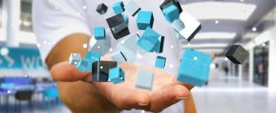 Zakenmanholding die blauwe glanzende 3D renderin van het kubusnetwerk drijven Royalty-vrije Stock Foto