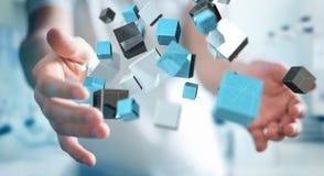 Zakenmanholding die blauwe glanzende 3D renderin van het kubusnetwerk drijven Royalty-vrije Stock Foto's