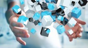 Zakenmanholding die blauwe glanzende 3D renderin van het kubusnetwerk drijven Stock Afbeelding