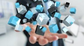 Zakenmanholding die blauwe glanzende 3D renderin van het kubusnetwerk drijven Stock Fotografie