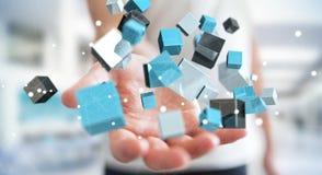 Zakenmanholding die blauwe glanzende 3D renderin van het kubusnetwerk drijven Stock Foto