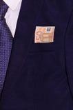 Zakenmankostuum met geld in de zak Stock Foto's