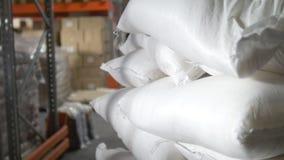 Zakken met suiker binnen een groot industrieel pakhuis stock video