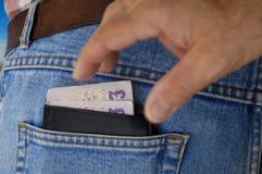 Zakkenroller in actie - Portefeuille. stock afbeelding