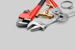 Zakończenia srebra narzędzia na popielatym tle Zdjęcie Royalty Free