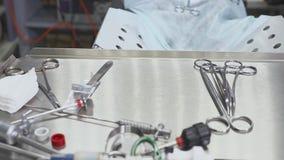 Zakończenia up ręki i stół chirurgicznie pielęgniarka podczas laparoscopic operaci zbiory