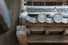 Zakończenia up szczegóły Hanagawara lub dachowej płytki ornamentacja z projektami w tradycyjnej Japońskiej architekturze kwiecist zdjęcie royalty free