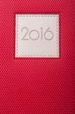 Zakończenie czerwony dzienniczek lub agenda z bieżącym rokiem Obraz Royalty Free