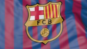 Zakończenie falowanie flaga z FC Barcelona futbolu klubu logem obraz stock