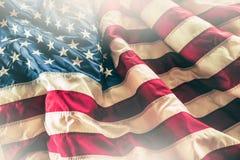 Zakończenie flaga amerykańskiej falowanie w wiatrze fotografia royalty free