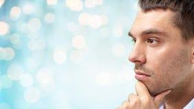Zakończenie męska twarz nad błękitem up zaświeca tło Fotografia Stock