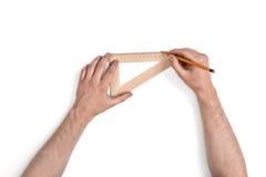 Zakończenie ręki mężczyzna podczas gdy pracujący proces z trójboka centymetra władcą Fotografia Royalty Free