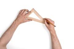 Zakończenie ręki mężczyzna podczas gdy pracujący proces z trójboka centymetra władcą Zdjęcia Stock