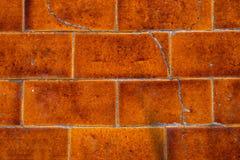 Zakończenie stary emaliowy ceramiczny brickwork z pęknięciami Zdjęcia Royalty Free