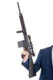 Zakończenie trzyma maszynowego pistolet mężczyzna ręka Zdjęcia Stock