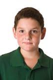 Młoda chłopiec jest ubranym zieloną polo koszula Obrazy Stock