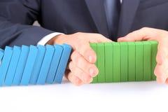 Zakończenie Zatrzymuje skutek domino Z ręką biznesmen Zdjęcie Stock