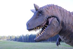 Zakończenie irrealny dinosaur przeciw krajobrazowi Zdjęcie Royalty Free
