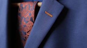 Zakończenie kostium kurtki lapel guzika dziury tkanina Fotografia Stock