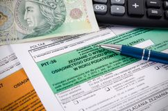 Zakończenie Polski podatek dochodowy up tworzy na biurku Obraz Royalty Free