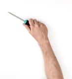 Zakończenie widok man& x27; s ręka z śrubokrętem, odizolowywającym na białym tle Obrazy Stock