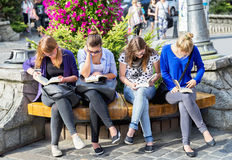 Zakopane, Poland - August 24, 2015: Girls reading books. Stock Photos