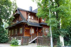 Wooden residential house among trees Royalty Free Stock Photos