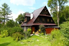 Wooden house surrounded by a garden Stock Photography