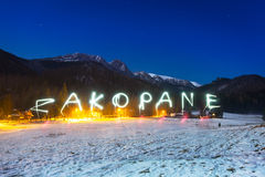 Zakopane sign under Tatra mountains at night Royalty Free Stock Photos