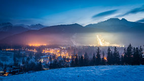 Zakopane during the skiing competitions at dusk in winter Royalty Free Stock Photos