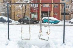 zakrywać śnieżne huśtawki zdjęcie royalty free