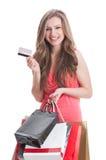 Zakupy dama używa kredyt lub kartę debetową Zdjęcia Stock