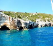 Zakynthos blue caves. Beautiful rock formations with water mirroring Stock Images