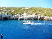 Zakynthos blue caves boat. Beautiful rock formations with water mirroring Royalty Free Stock Photography