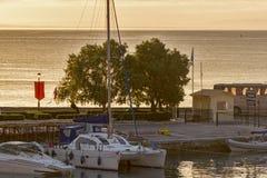 Amazing sunrise view from costal street of Zakynthos City, Ionian island, Greece. ZAKYNTHOS, GREECE - MAY 28, 2015: Amazing sunrise view from costal street of royalty free stock image