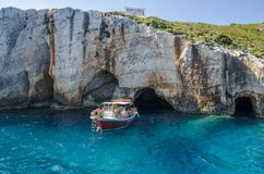 People on a motor boat enjoying a boat trip to the famous natural Blue Caves royalty free stock photos