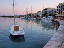 Zakynthos Harbor, Dusk. Zakynthos harbour at dusk. Pleasure craft, recreational boats. Town lights reflected in water Royalty Free Stock Photos