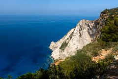 Zakynthos Island, Greece. View on horizon, rocky shore and turquoise, crystal clear waters of Ionian Sea.  royalty free stock images