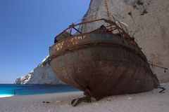 Zakynthos Shipwreck. The famous shipwreck at Zakynthos (Zante) in a beautifull bay on a sandy beach surrounded by cliffs stock image