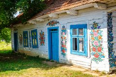 Zalipie, Poland, August 19, 2018: Colourful house with flowers painted on walls and sundial in the village of Zalipie, Poland. It. Is known for a local custom royalty free stock photography