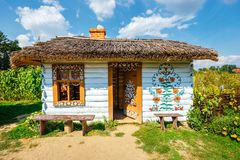 Zalipie, Poland, August 19, 2018: Colourful house with flowers painted on walls and sundial in the village of Zalipie, Poland. It. Is known for a local custom stock images