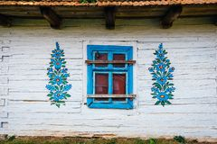 Zalipie, Poland, August 19, 2018: Facade of a traditional colorful building in Zalipie village in Poland. It is known for a local. Custom of painting the stock image