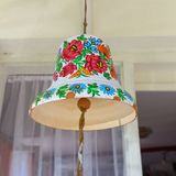 Painted old ceramic bell decorated with a hand painted colorful flowers, Zalipie, Poland. ZALIPIE, POLAND - AUGUST 3, 2018: Painted ceramic bell decorated with a royalty free stock photos