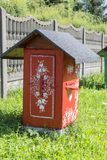 Old wooden beehives decorated with a hand painted colorful flowers, Zalipie, Poland. ZALIPIE, POLAND - AUGUST 3, 2018: Painted old wooden beehives decorated with stock images