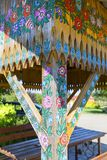 Painted old wooden bower decorated with a hand painted colorful flowers, Zalipie, Poland. ZALIPIE, POLAND - AUGUST 3, 2018: Painted old wooden bower decorated royalty free stock photography
