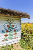 Painted old wooden cottage decorated with a hand painted colorful flowers, Zalipie, Poland. ZALIPIE, POLAND - AUGUST 2, 2018: Painted old wooden cottage stock images
