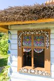Painted old wooden cottage decorated with a hand painted colorful floral motives, folk art, Zalipie, Poland. ZALIPIE, POLAND - AUGUST 2, 2018: Painted old wooden royalty free stock photo